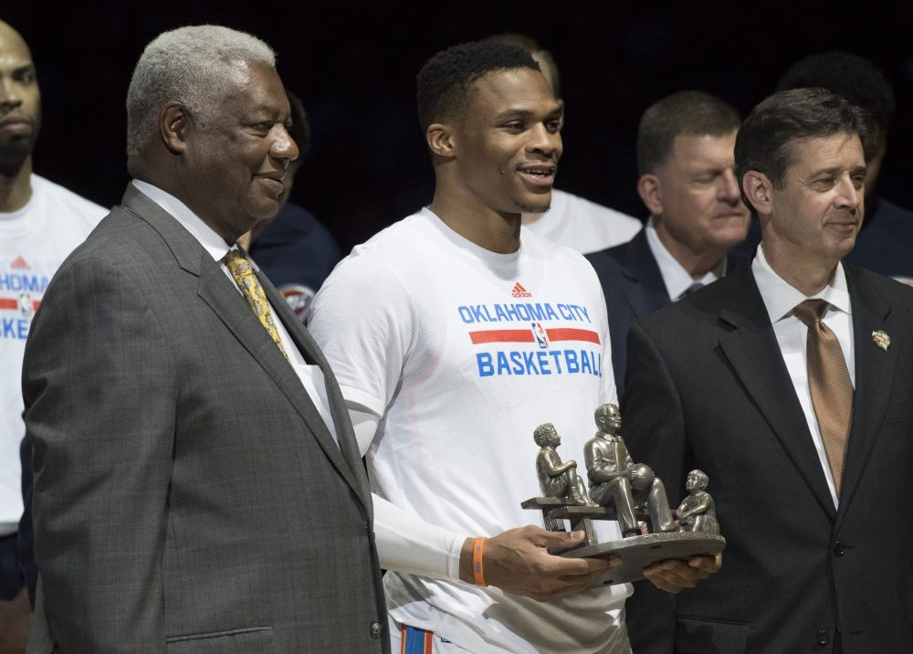 Russell Westbrook (center) received a trophy for breaking Oscar Roberston's (left) triple-double record. (J Pat Carter/Getty Images)