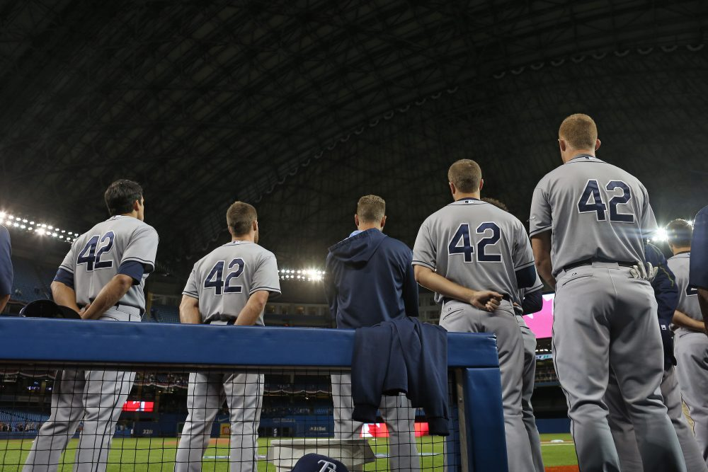 """""""It's a lovely gesture for each Major League player to wear his '42' on Jackie Robinson Day,"""" Bill Littlefield writes. """"But wouldn't Jackie Robinson be among the first to affirm that symbols and gestures are nothing compared to the eventual realization of genuine equal rights and opportunity, and the full realization of justice in all its manifestations for everybody?"""" (Tom Szczerbowski/Getty Images)"""