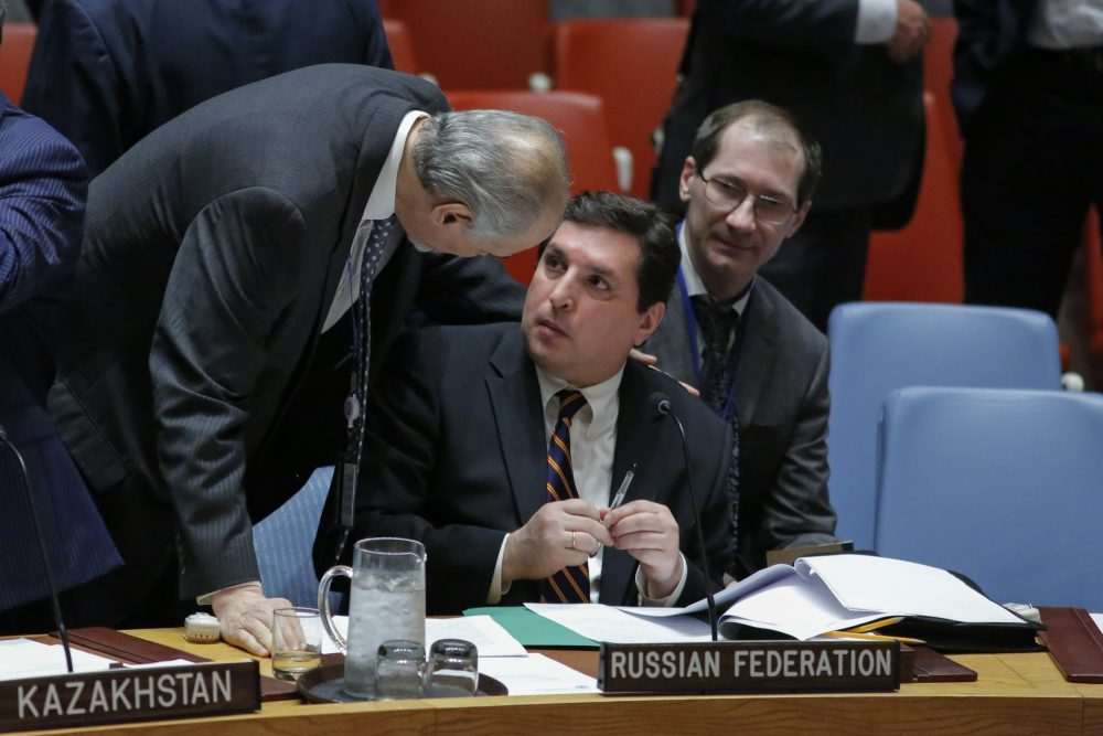 Russian Deputy Permanent Representative to the U.N. Vladimir Safronkov (right) speaks with Syrian Ambassador to the U.N. Bashar Jaafari (left) before they attend a meeting to vote on a Draft resolution that condemns the reported use of chemical weapons in Syria at the Security Council on April 12, 2017. (Kena Betancur/AFP/Getty Images)