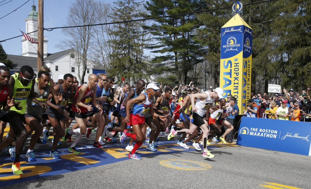 Meb Keflezighi, of San Diego, center, breaks from the start with Galen Rupp, as they lead the men's elite runners at the starting line. (Mary Schwalm/AP)