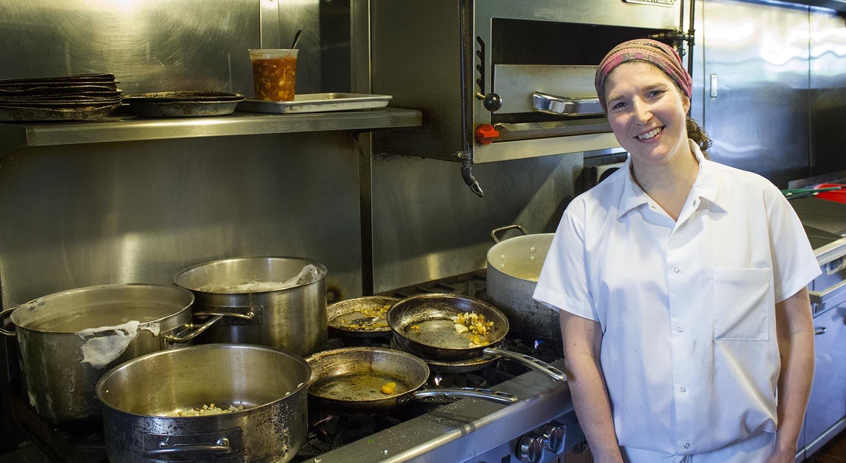 Cassie Piuma in the kitchen of Sarma. (Alison Bruzek/WBUR)