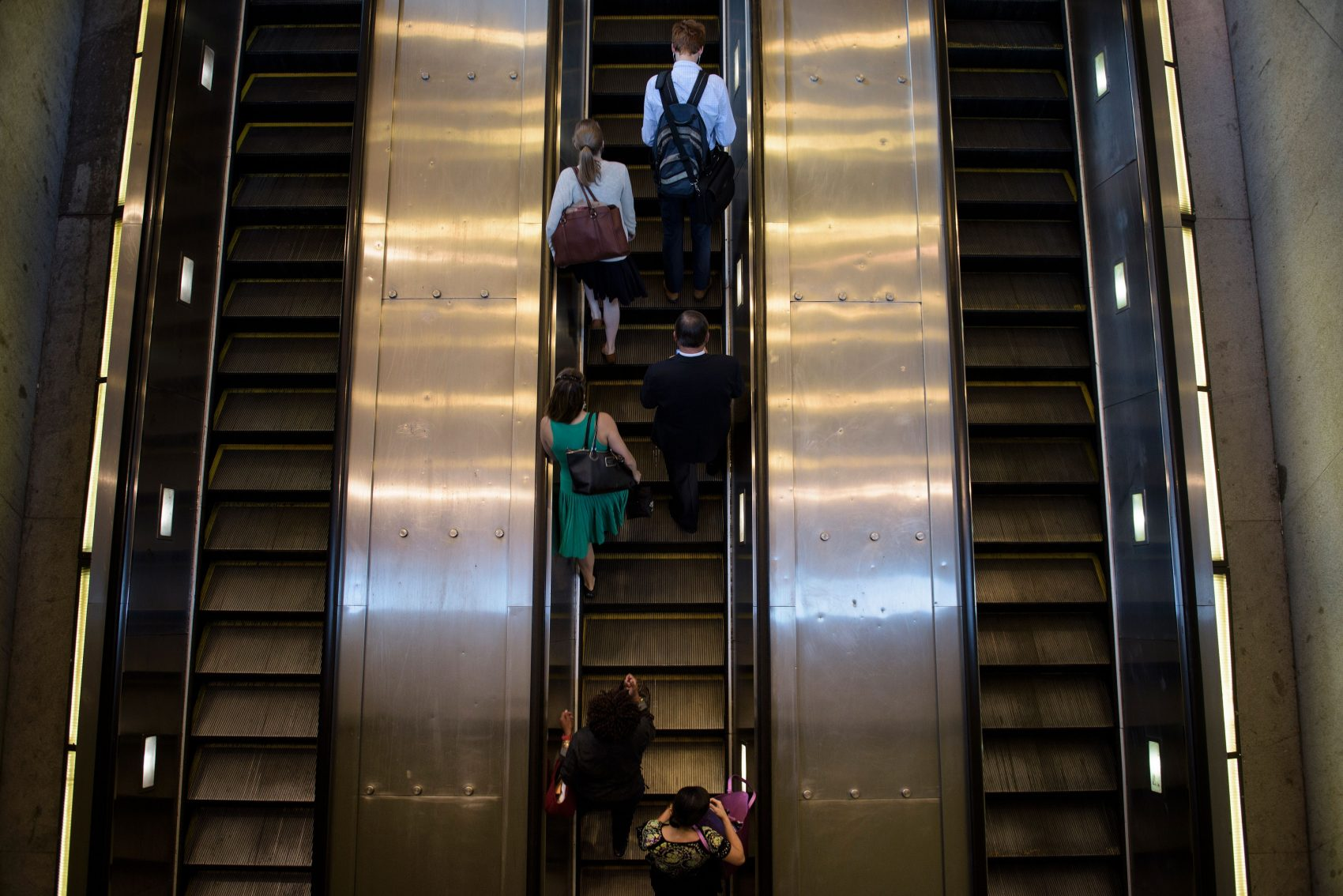 People ride an escalator to exit the Metro transit system in Washington, D.C. (Brendan Smialowski/AFP/Getty Images)