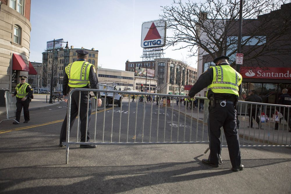 Police set up a barricade on Brookline Avenue in Kenmore Square before the 2016 Boston Marathon. (Jesse Costa/WBUR)