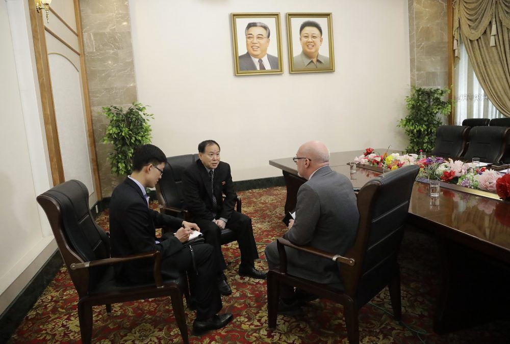 Han Song Ryol, center, North Korea's vice minister of foreign affairs speaks during an interview with Eric Talmadge, right, of The Associated Press on Friday, April 14, 2017, in Pyongyang, North Korea. (Wong Maye-E/AP)