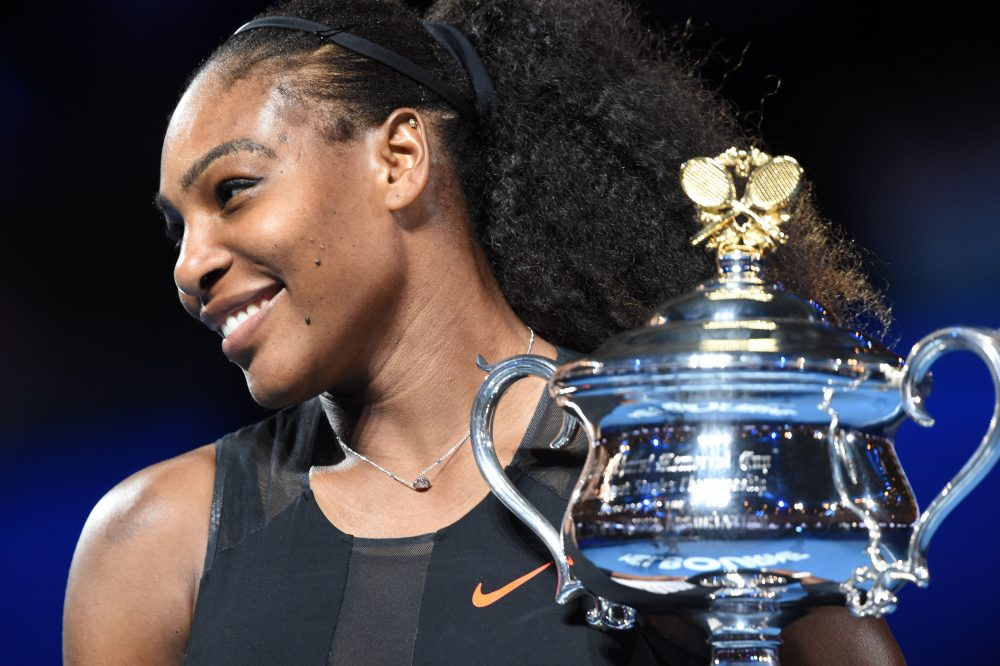 Serena Williams holds up the trophy following her victory over her sister Venus Williams in the women's singles final of the Australian Open tennis tournament in Melbourne on Jan. 28, 2017. (Paul Crock/AFP/Getty Images)