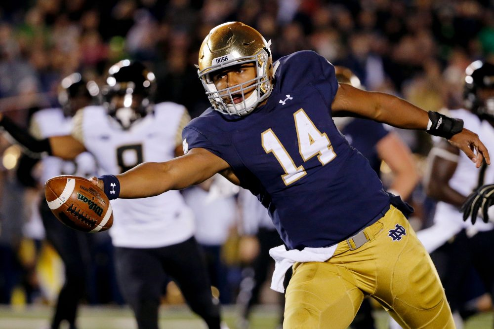Hoping to be a top pick in the NFL Draft, DeShone Kizer has branded himself as a Tom Brady-Cam Newton hybrid. (Jon Durr/Getty Images)