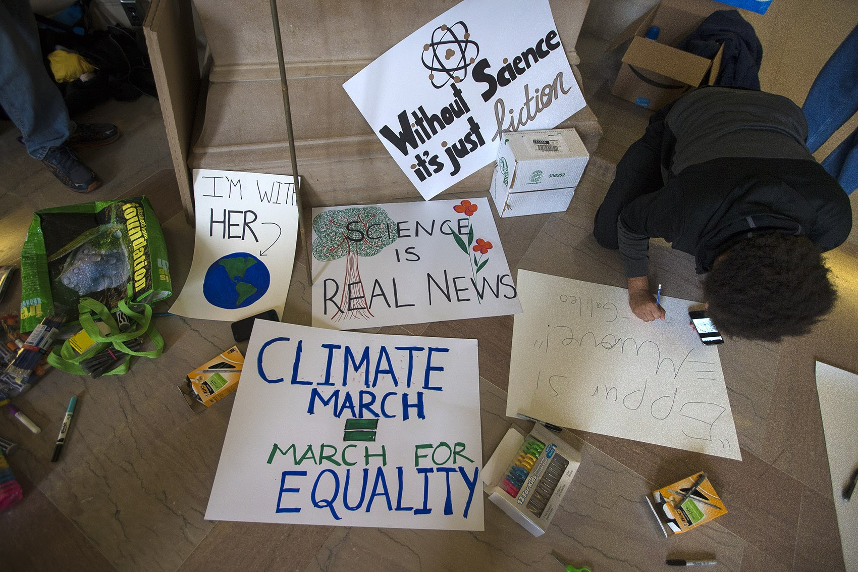 Signs being made by MIT students and faculty Saturday in support of Boston's March For Science. (Jesse Costa/WBUR)