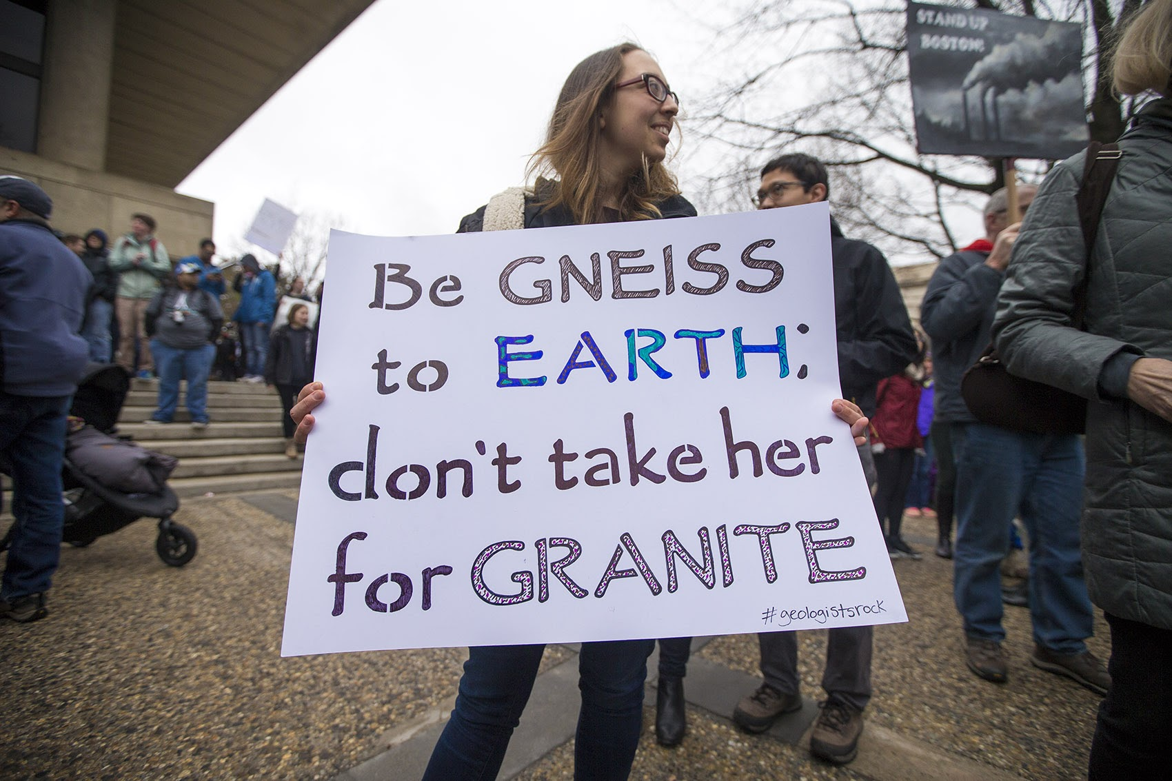 Holly Taylor of Northeastern University with a sign she created for the March for Science in Boston. (Jesse Costa/WBUR)