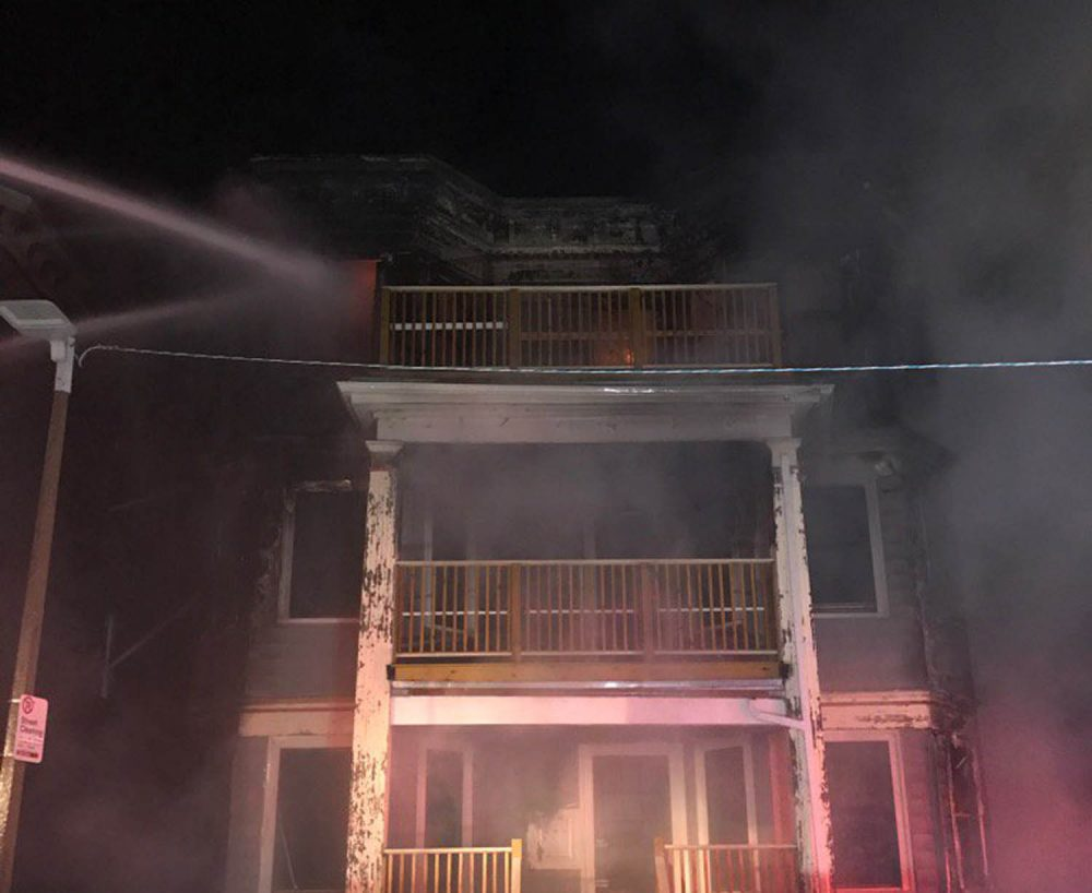 An early morning fire in Dorchester Sunday damaged four triple decker homes and displaced 17 residents. (Courtesy Boston Fire Department)