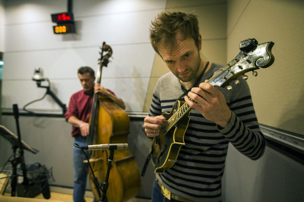 Chris Thile, right and Edgar Meyer playing with Yo-Yo Ma. (Jesse Costa/WBUR)