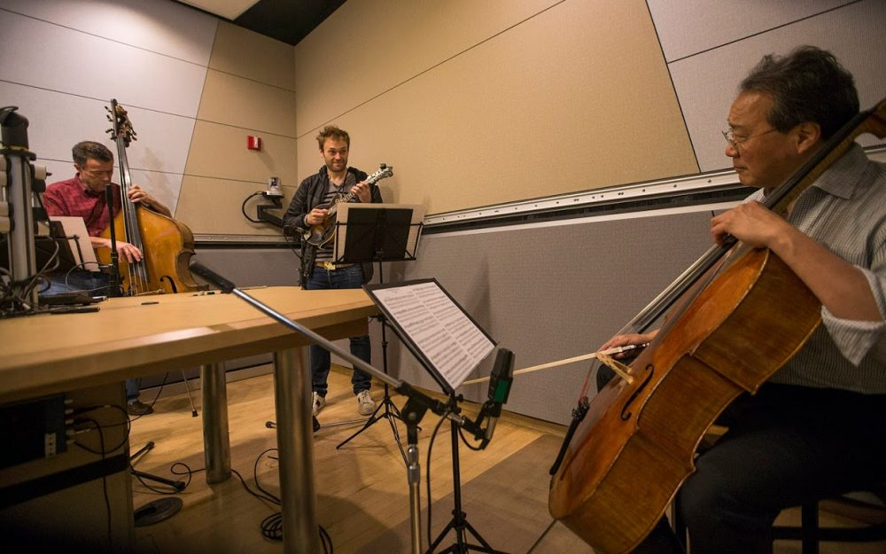 Yo-Yo Ma (right) playing with Chris Thile (center) and Edgar Meyer in the WBUR studios. (Jesse Costa/WBUR)