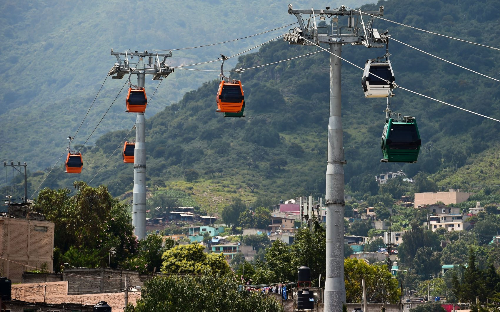 A view of cable cars in Ecatepec, Mexico, on Aug. 25, 2016. Dozens of murals were painted on buildings in a neighborhood in Ecatepec, on the route of a new cable car that started running in 2016. (Ronaldo Schemidt/AFP/Getty Images)