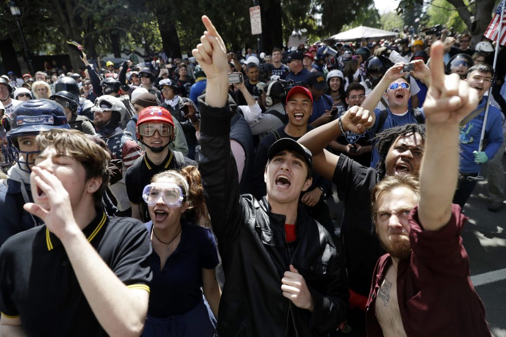 Demonstrators shout slogans directed at city hall during a rally for free speech Thursday, April 27, 2017, in Berkeley, Calif. (Marcio Jose Sanchez/AP)