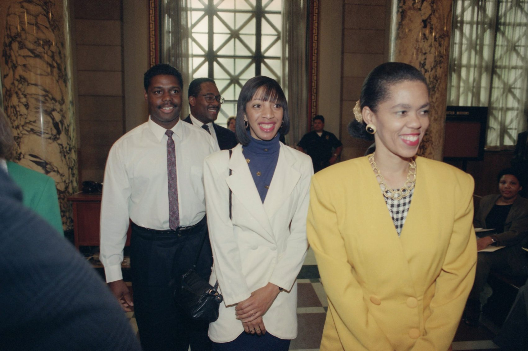 Four Los Angeles residents who rescued truck driver Reginald Denny from his rig after he was beaten during the first night of rioting were awarded a heroes' welcome at Los Angeles City Council, May 5, 1992. From right to back are Lei Yuille, Terri Barnett, Titus Murphy and Gregory Alan Williams. (Bob Galbraith/AP)