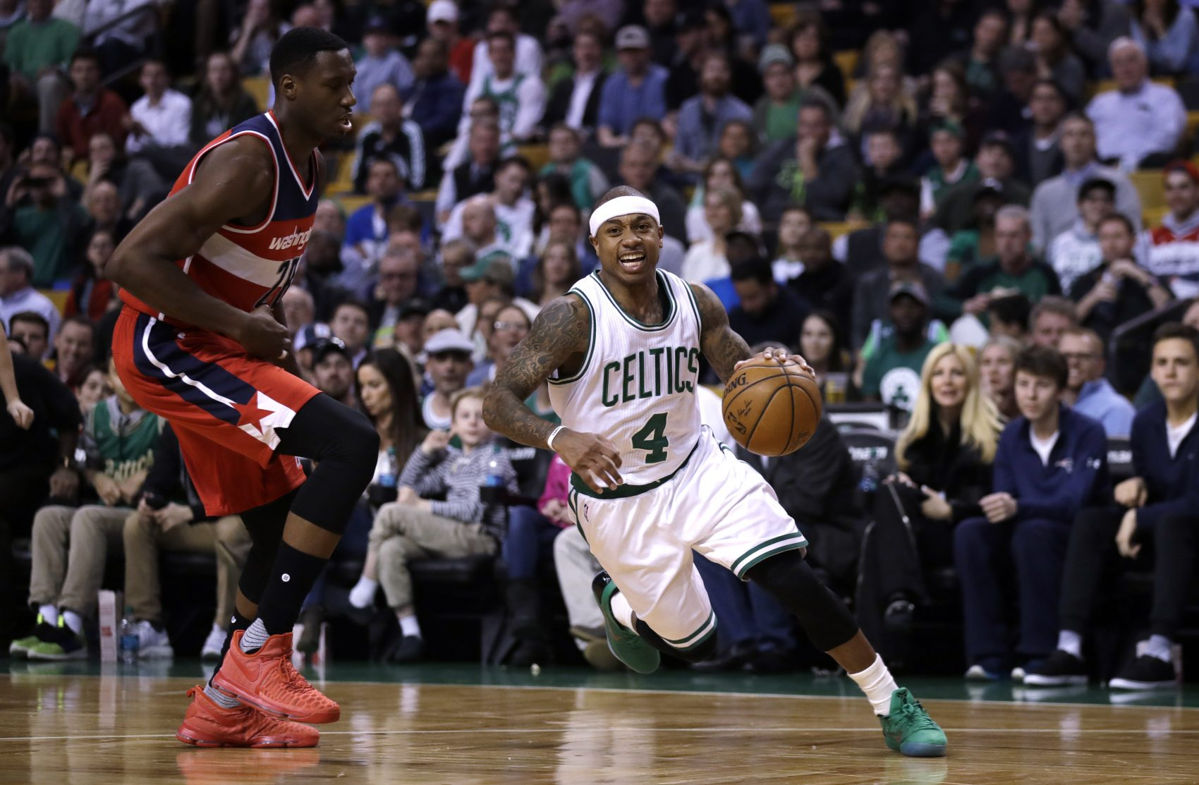 Boston Celtics guard Isaiah Thomas drives to the basket against the Wizards in March. (Charles Krupa/AP)
