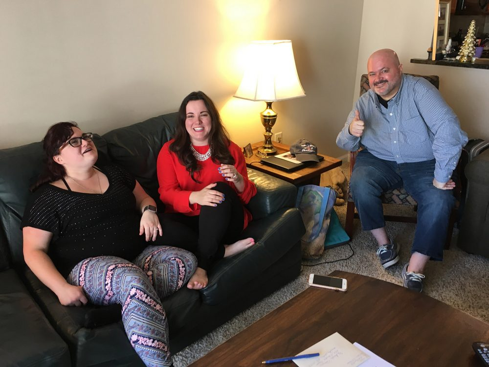 From left, Niki Ilse, Kelly Best and Sean Bunn in Sean's living room in Raleigh. (Lynn Jolicoeur/WBUR)