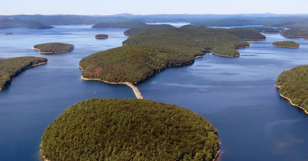 In this September 2013 handout photo, a dirt road leads to Mount Zion Island, at rear, at the Quabbin Reservoir in Petersham. (Clif Read/Mass. Dept. of Conservation and Recreation via AP)