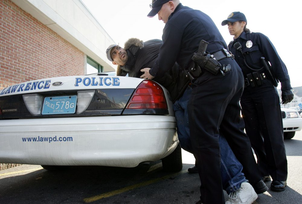 Mayor Dan Rivera's defense of an aggressive police officer, writes Alex Ramirez, is deeply troubling. Pictured: In this file photo, Luis Rivera, of Haverhill, is arrested by Lawrence Police Officers Carmen Purpora, front, and Eli Bernabe, in a supermarket parking lot in Lawrence on March 14, 2006. Rivera was charged in connection with shoplifting, resisting arrest, disorderly conduct, and possession of drug paraphernalia with intent to sell. (Steven Senne/AP)