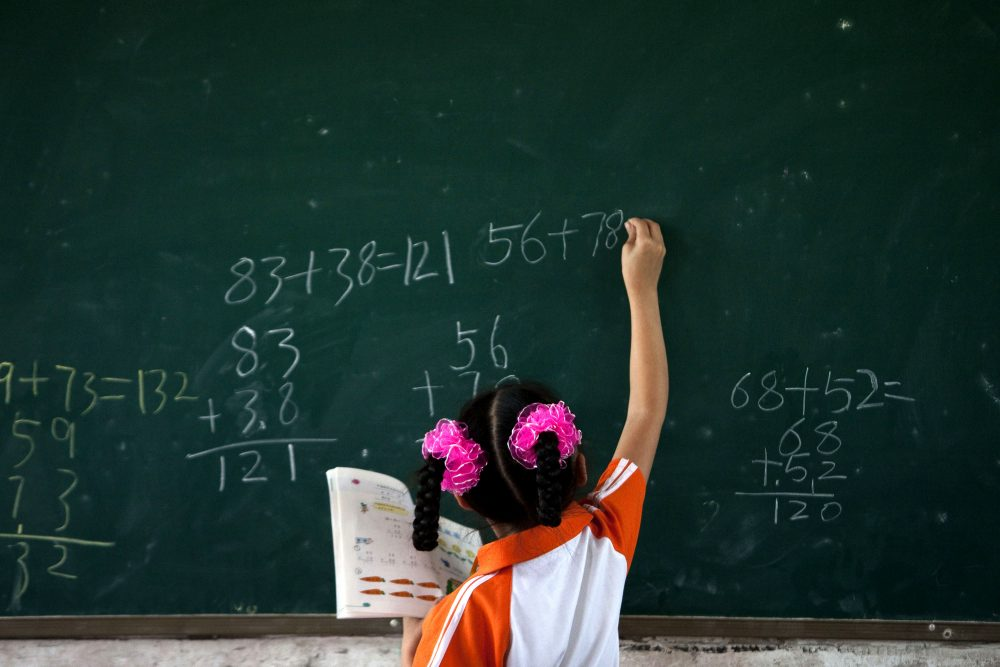 Massachusetts students have received the top scores on a national math test for more than a decade -- but when you zoom out and look globally, the state ranks 20th in the world. (Alexander F. Yuan/AP File)