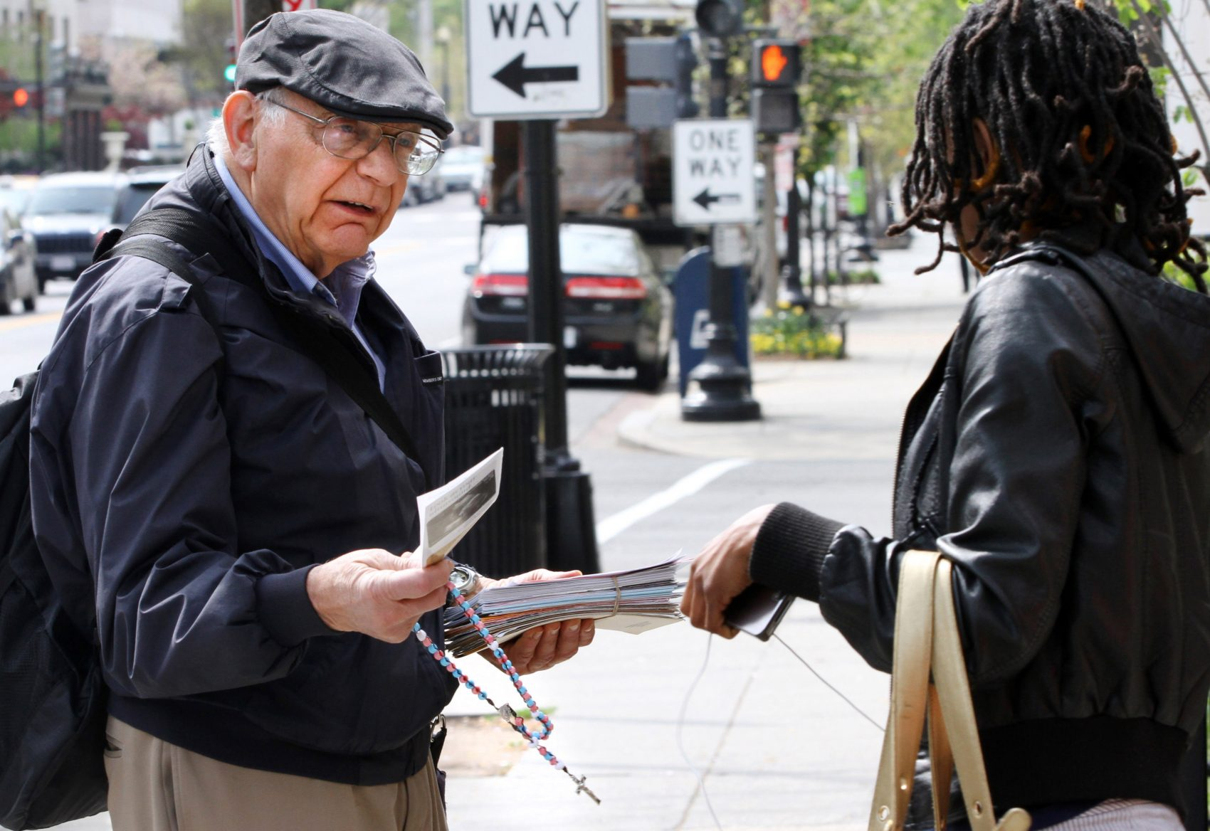 Not talking about abortion, writes Carol Sanger, distorts the public debate, which influences the legislative process. Pictured: Richard Retta, 80, left, hands an anti-abortion flyer to a woman as she leaves Planned Parenthood in Washington on April 4, 2012. (Jacquelyn Martin/AP)
