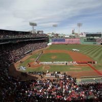 The Boston Children's Chorus performs the national anthem behind second base as the Pittsburgh Pirates, left, and Boston Red Sox stand along the baselines before their opening day baseball game at Fenway Park, on Monday. (AP/Steven Senne)