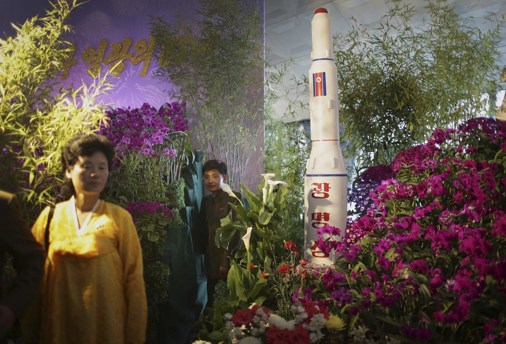 North Koreans walk past a model of a rocket at a flower festival as part of celebrations to mark the 105th birth anniversary of late leader Kim Il Sung on Sunday, April 16, 2017, in Pyongyang, North Korea. A North Korean missile exploded during launch Sunday, U.S. and South Korean officials said, a high-profile failure that comes as a powerful U.S. aircraft supercarrier approaches the Korean Peninsula in a show of force. (Wong Maye-E/AP)