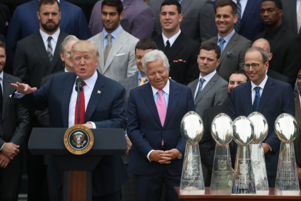 Patriots owner Robert Kraft, center, and others listen as President Trump speaks during a ceremony on the South Lawn of the White House on Wednesday. (Andrew Harnik/AP)