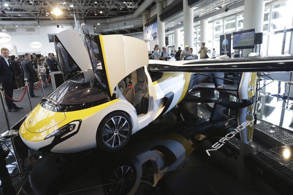 """Why does this complicated and ambitious dream endure? asks Tom LeCompte, a pilot -- and a driver. Pictured: The latest version of a flying car called """"AeroMobil"""", a light frame plane with wings that can fold back, like an insect, boosted by a rear propeller, is displayed in Monaco, Thursday, April 20, 2017. The company said that its """"AeroMobil is completely integrated aircraft as well as a fully functioning four-wheeled car, powered by hybrid propulsion."""" (Claude Paris/AP)"""