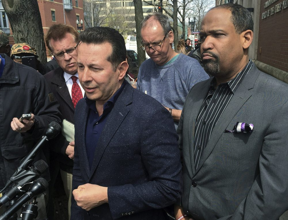 Attorneys Jose Baez and Ronald Sullivan, who successfully defended former New England Patriots player Aaron Hernandez in a double-murder case, outside the state medical examiner's office (Collin Binkley/AP)
