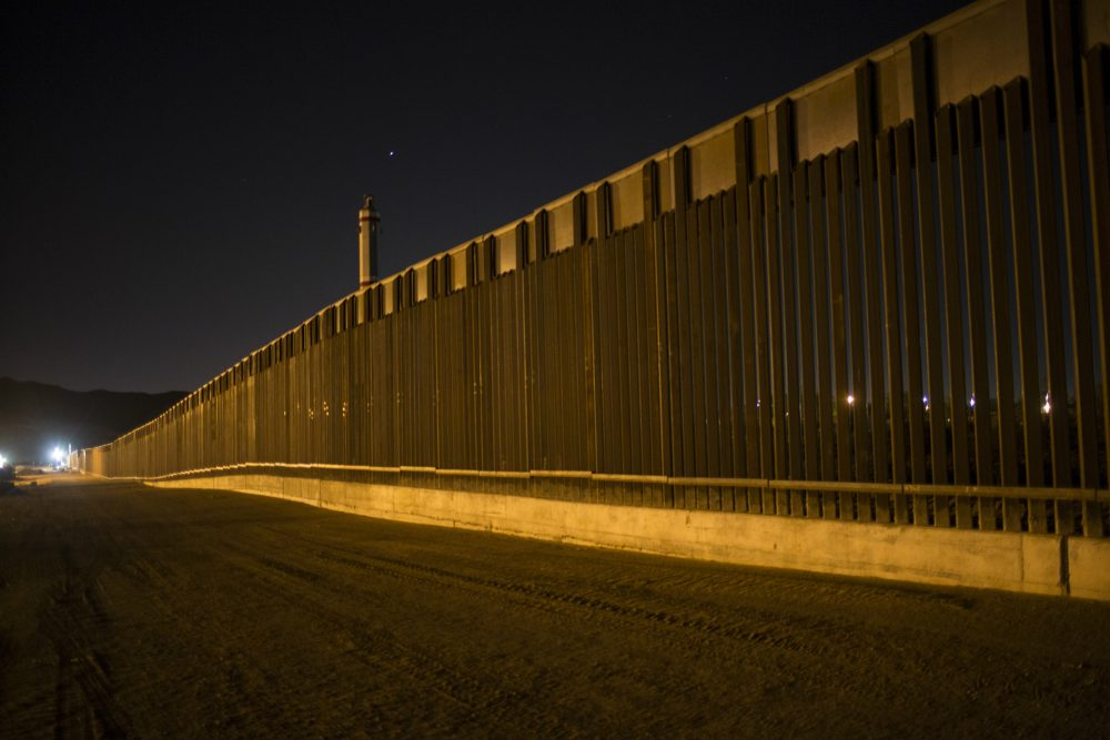 Even if you believe good fences make good neighbors, writes Rich Barlow, $21 billion is a lot to drop on an undocumented-immigrant problem that candidate Trump exaggerated. Pictured: A portion of the new steel border fence stretches along the U.S.-Mexico border in Sunland Park, New Mexico, Thursday, March 30, 2017. This fencing just west of the New Mexico state line was planned and started before President Donald Trump's election, adding to the 650 miles of fences, walls and vehicle barriers that already exist along the nearly 2,000-mile frontier. (Rodrigo Abd/AP)