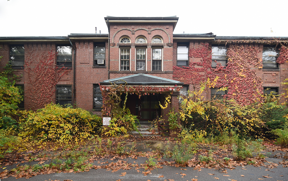 Pictured here: The Walter E. Fernald Developmental Center's MacDougall Hall, constructed in 1898 by noted architect William Gibbons Preston. It was originally built as a girls dormitory, and was in use until a decade ago. (Courtesy of David Whitemyer)