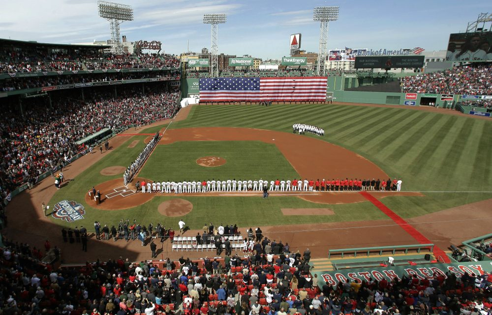 The Pittsburgh Pirates, left, and Boston Red Sox stand along the baselines before their opening day baseball game at Fenway Park, Monday, April 3, 2017, in Boston. (Steven Senne/AP)