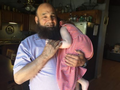 Mohamed Bzeek with his current foster daughter. (Erika Aguilar for WBUR)