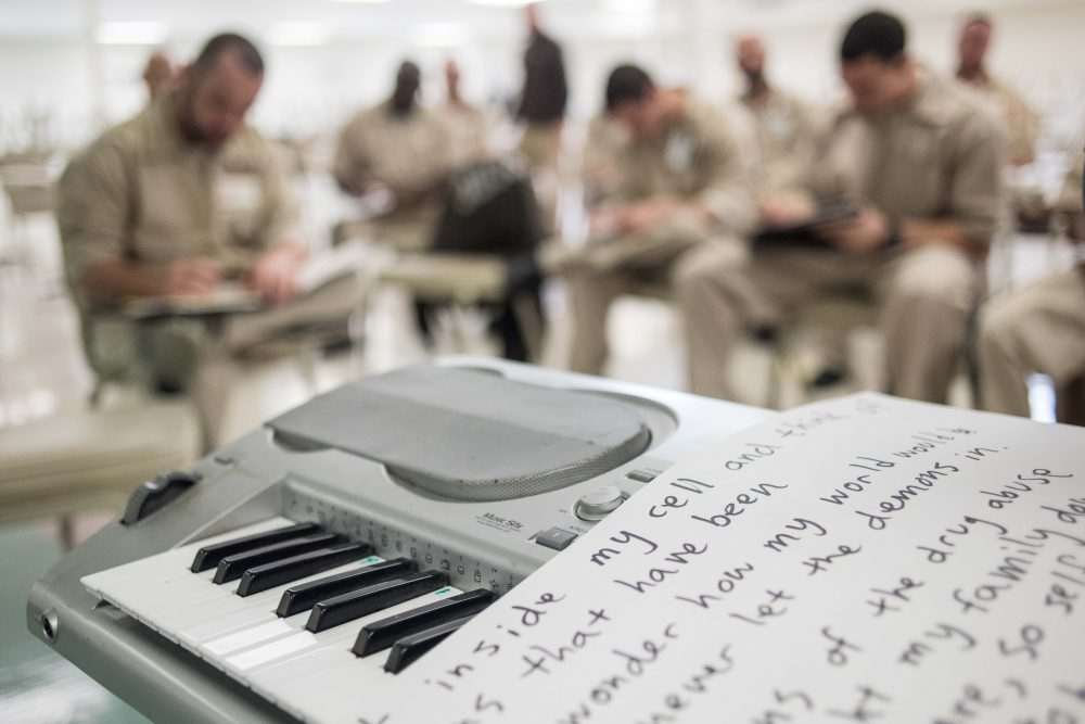 What emerging writers need most is not motivation but access, writes Eve Bridburg, and the NEA's role in this effort is crucial. Pictured: Inmates participate in a lyric writing exercise during a music workshop at the Lee Correctional Institution in Bishopville, S.C. in 2016. (Sean Rayford/AP)