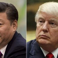 This combination of file photos show U.S. President Donald Trump, right, in a meeting at the White House in Washington, on March 31, 2017,  and China's President Xi Jinping  in a meeting at the Great Hall of the People in Beijing, on Dec. 1, 2016. (AP)