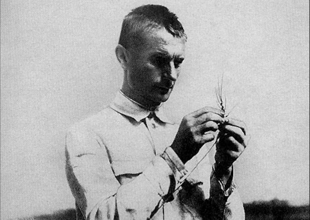"""Soviet """"scientist"""" Trofim Lysenko examines some wheat. His infamy stemmed in part from his pseudoscientific claims about agriculture. (Wikimedia Commons)"""