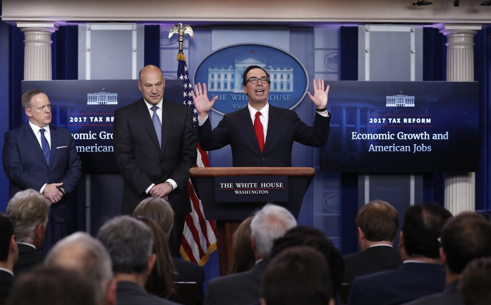 Treasury Secretary Steven Mnuchin, center, joined by National Economic Director Gary Cohn and White House press secretary Sean Spicer in the briefing room of the White House. (Carolyn Kaster/AP)