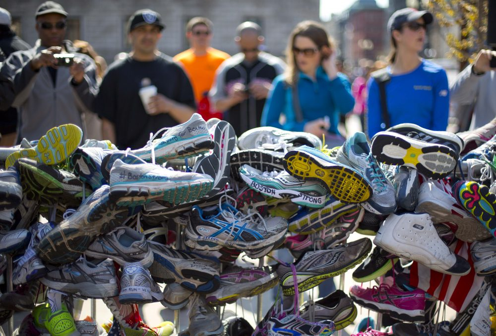 After two terrorist bombs shattered lives at the 2013 Boston Marathon, writes Richard Beinecke, public support has helped heal psychic wounds.. Pictured: A collection of running shoes in a makeshift memorial honoring the victims of the Boston Marathon bombing in Copley Square, Saturday, April 27, 2013, (Robert F. Bukaty/AP)
