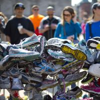 After two terrorist bombs shattered lives at the 2013 Boston Marathon, writes Richard Beinecke, public support has helped heal psychic wounds. Pictured: A collection of running shoes in a makeshift memorial honoring the victims of the Boston Marathon bombing in Copley Square, Saturday, April 27, 2013, (Robert F. Bukaty/AP)