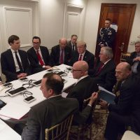 In this image provided by the White House, President Donald Trump receives a briefing on the Syria military strike from his National Security team after the strike at Mar-a-Lago in Palm Beach, Fla. (White House via AP)
