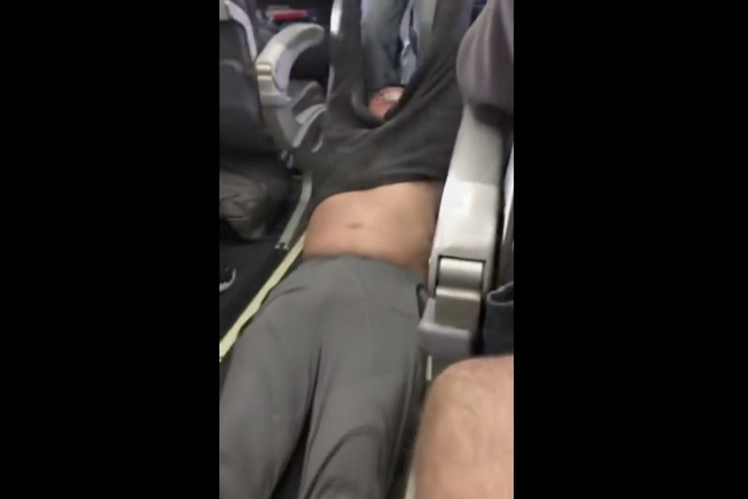 This Sunday, April 9, 2017, image made from a video provided by Audra D. Bridges shows a passenger being removed from a United Airlines flight in Chicago. (Audra D. Bridges via AP)
