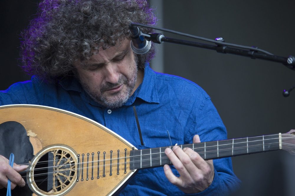 George Xylouris plays a Cretan lute. (Jesse Costa/WBUR)