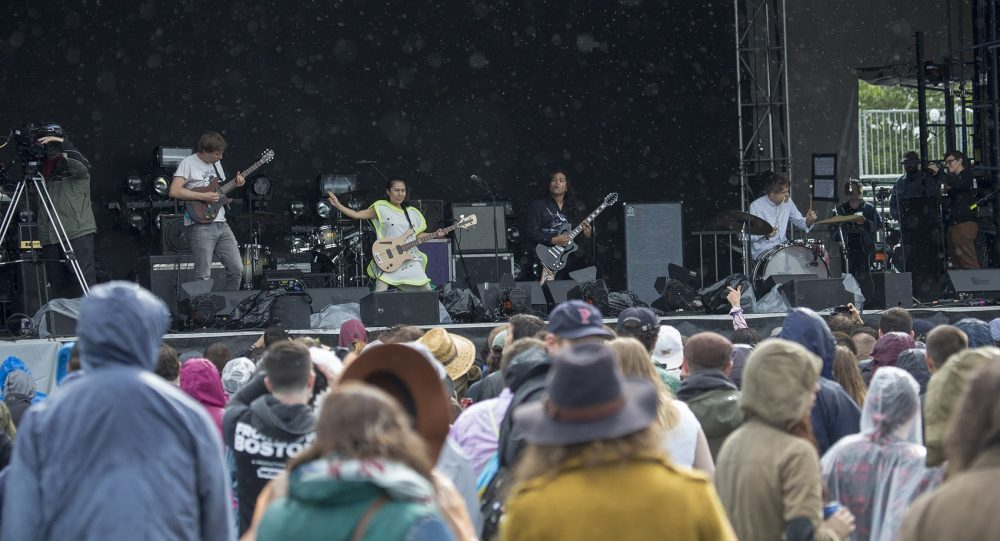 Deerhoof performs to a rain soaked crowd Friday afternoon. (Jesse Costa/WBUR)