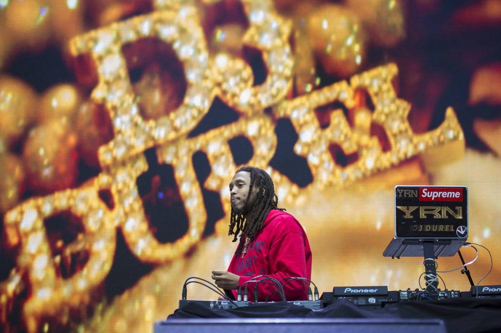 DJ Durel, of Migos, gets the crowd warmed up at Boston Calling. (Jesse Costa/WBUR)