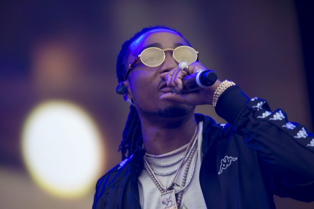 Quavo, of Migos, emerges onto the stage. (Jesse Costa/WBUR)
