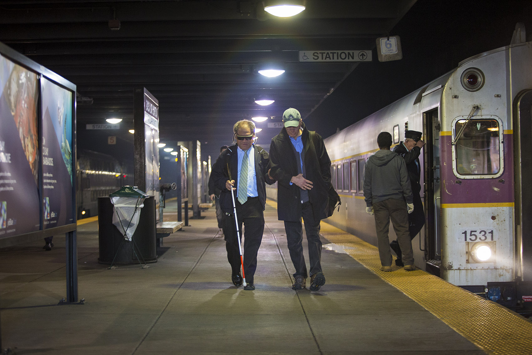 Whenever they're on the same commuter rail train, David Hill, right, meets Blair Wong on the platform at Back Bay station and walks him to Benjamin Franklin Institute of Technology. (Jesse Costa/WBUR)