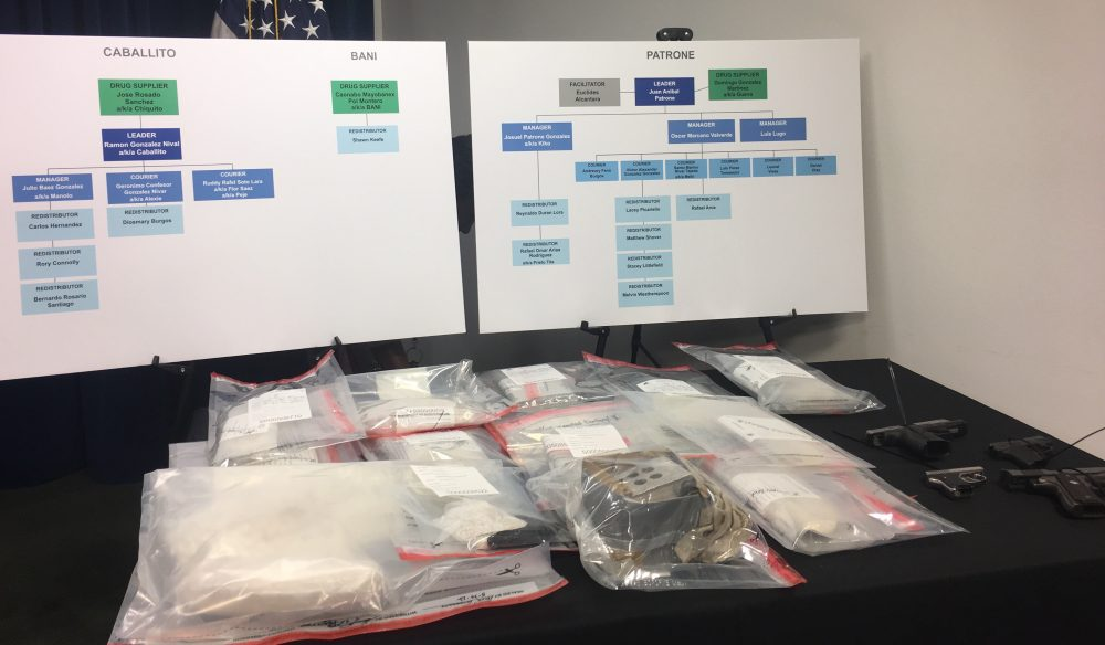At a press conference Tuesday at the Moakley Courthouse, federal authorities displayed suspected fentanyl and guns they seized in an early-morning sweep of an alleged drug trafficking operation based in Lawrence. (Katie Lannan/State House News Service)