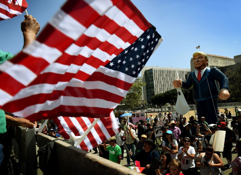 """Members of the """"Full Rights for Immigrants Coalition"""" displayed a giant effigy of then-candidate Donald Trump during a protest on May Day in Los Angeles in 2016. (Mark Ralston/AFP/Getty Images)"""