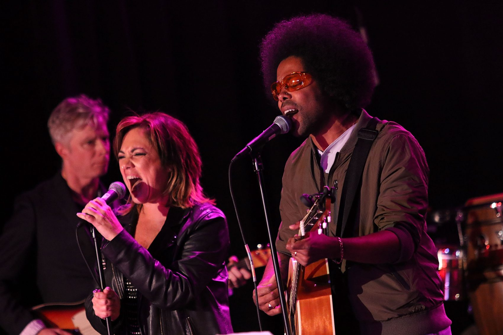 Singers Claudia Brant and Alex Cuba perform onstage during a concert in 2015. (JC Olivera/Getty Images for ASCAP, BMI, SESAC & Los Producers Charity Concert)