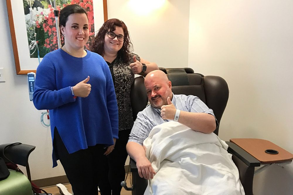 Kelly Best, left, and Niki Ilse with Sean Bunn at the chemotherapy lab at Duke Cancer Center in March. (Courtesy Sean Bunn)